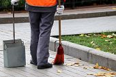 Janitor Sweeping The Fallen Leaves On A Autumn Street. Cleaning Leaves In The City, Street Sweeper W poster
