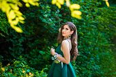 Beautiful Brunette Girl In Glamorous Green Dress In Nature. Ready For Prom Night poster