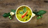Top View Of Green Curry Fish Ball (thai Food) In White Bowl On Wood Table, Look Delicious. poster