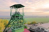 Winding tower of old underground coal mine. Air pollution, emissions and climate change theme. poster