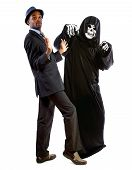 Man In A Grim Reaper Halloween Ghost Costume Having Fun And Scaring A Grown Businessman In A Suit.   poster