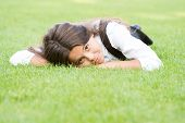 Lovely Relaxed Look. Adorable Girl With School Look Relax On Green Grass. Cute Little Child Have Sch poster
