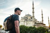 Tourist With A Backpack On The Background Of The Blue Mosque In Istanbul In Turkey. Sightseeing. poster