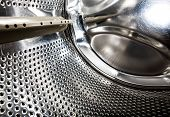 foto of washing machine  - A detail of a washing machine front loading - JPG