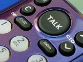 pic of long distance relationship  - Close up of the talk button on a cordless home phone - JPG