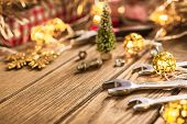 Handy Tools On Christmas Time Background Concept. Wrenches And Handy Tools With Christmas Ornament D poster