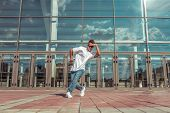 Male Athlete Dancing Glass Window Background, Summer City, Hip Hop Style, Break Dancer. Free Space M poster