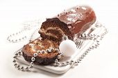 christmas chocolate yule log and decoration on white background poster