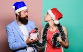 Christmas Party Office. Happy Man And Woman Wear Santa Hats. Cheerful Couple Celebrate New Year. Giv poster