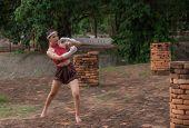 Ancient Thailand Martial Art Called Muay Thai. Thai Woman Practice Thai Kick Boxing. poster