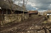 image of stockade  - Dirt road passing through the small village - JPG