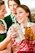 pic of stein  - Young people in traditional Bavarian Tracht in restaurant or pub with beer and steins - JPG