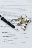 stock photo of deed  - Real estate contract with pen and keys - JPG