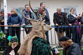 HASTINGS, ENGLAND - MAY 7: A man wearing a deer head takes parts in a parade through the Old Town du