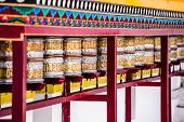 picture of mantra  - Buddhist prayer wheels in Tibetan monastery with written mantra. India Himalaya Ladakh ** Note: Shallow depth of field - JPG