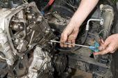foto of overhauling  - Repairing of diesel engine close up of worker hands - JPG