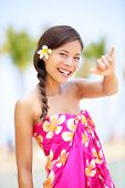 picture of hawaiian girl  - Hawaii beach woman making Hawaiian shaka hand sign - JPG