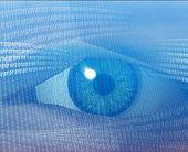 stock photo of binary code  - eye viewing electronic information - JPG