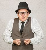 pic of insulting  - Insulted white male with eyeglasses clenching fists - JPG