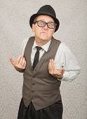 picture of headstrong  - Upset white businessman with hat and eyeglasses - JPG