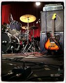 Instagram style image of a guitar and drums on stage
