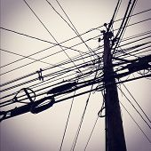 Instagram style images of utility pole and power lines