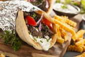 picture of gyro  - Homemade Meat Gyro with Tzatziki Sauce tomatos and French Fries  - JPG