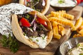 pic of gyro  - Homemade Meat Gyro with Tzatziki Sauce tomatos and French Fries  - JPG