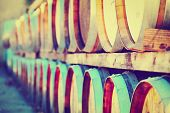 stock photo of chateau  - Wine Barrels Stacked in the Winery with filtered Effect  - JPG