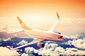 Airplane in flight. A big passenger or cargo aircraft, airline above clouds. Travel, transportation,