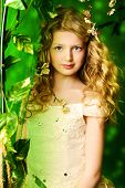 picture of loach  - Lovely girl in a lush white dress stands under a floral arch over green background - JPG