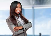 Smiling black business woman in her office