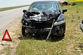 stock photo of bender  - accident car and warning triangle beside road - JPG