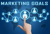 image of goal setting  - Marketing Goals concept with hand pressing social icons on blue world map background - JPG