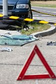 image of accident victim  - View of warning triangle after car accident - JPG