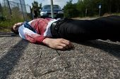 pic of blood drive  - Bleeding man lying on the street after car accident - JPG
