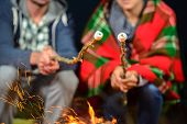 stock photo of romantic  - Tent camping couple romantic sitting by bonfire night countryside