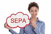 foto of bic  - Young woman looking at camera holding a SEPA sign isolated on white background - JPG