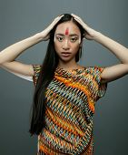 foto of indian chief  - beauty young asian girl with make up like Pocahontas - JPG