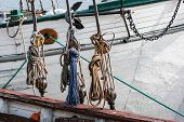 picture of pulley  - Part of sailing ship with pulleys and knotted ropes - JPG