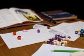 pic of throw up  - role playing game set up on table isolated on black background  - JPG