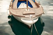 image of old boat  - Closeup photo of moored old white wooden boat - JPG