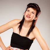 pic of pinup girl  - Young brunette woman summer teen girl retro pinup styling studio shot grey background - JPG