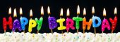 stock photo of birthday  - Happy birthday candles against a black background - JPG