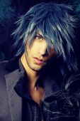 stock photo of sorcerer  - portrait of a handsome magician with blue hair - JPG