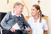 picture of retirement  - Nurse bringing supplies to senior woman in retirement home - JPG
