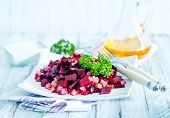 foto of beet  - beet salad on plate and on a table - JPG