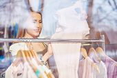 stock photo of boutique  - Elegant young woman shopping in boutique - JPG
