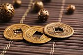 picture of copper coins  - Feng shui coins on table close - JPG