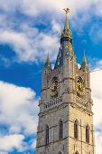 picture of gents  - View from the bottom up to the tower Belfry with a clock and a statue of a dragon in Ghent - JPG